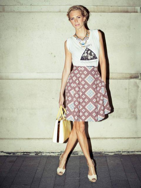 """<p>TDT t-shirt, <a href=""""http://www.elleuk.com/catwalk/designer-a-z/jonathan-saunders/autumn-winter-2012"""">Jonathan Saunders</a> skirt, <a href=""""http://www.elleuk.com/catwalk/designer-a-z/prada/autumn-winter-2012"""">Prada</a> bag, <a href=""""http://www.elleuk."""