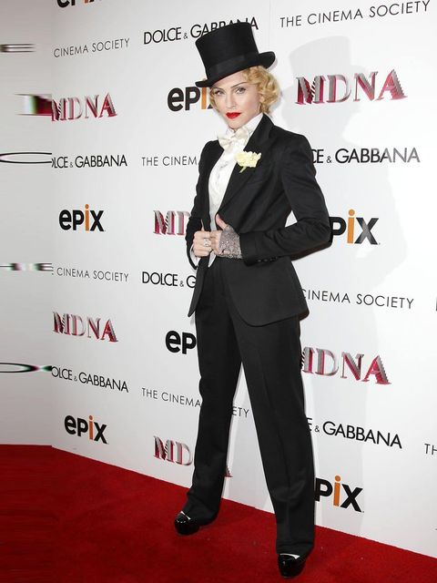 """<p>Madonna wore a three piece suite by <a href=""""attended%20the%20Dolce%20&%20Gabbana%20and%20The%20Cinema%20Society%20screening%20of%20the%20Epix%20world%20premiere%20of%20%E2%80%98Madonna%3A%20The%20MDNA%20Tour%E2%80%99%20at%20The%20Paris%20Theatre%2"""