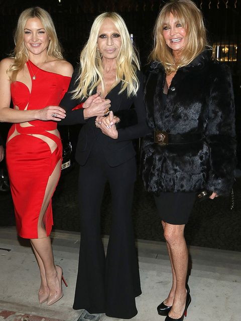 <p>Kate Hudson, Donatella Versace and Goldie Hawn at the Versace Couture show. </p>