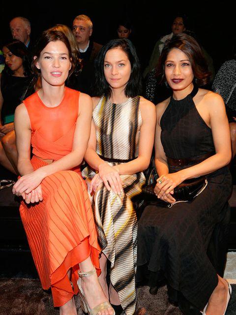 Hanneli Mustaparta, Leigh Lezark and Freida Pinto at the Salvatore Ferragamo a/w 2015 fashion show, Milan, March 2015.