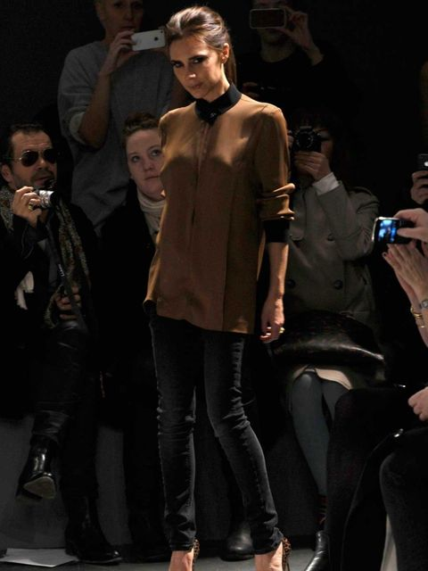 <p>Victoria takes her bow at Victoria, Victoria Beckham autumn/winter 2013</p>