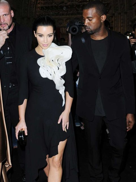 <p>Kim Kardashion and Kanye West attend the Stephane Rolland couture show</p>
