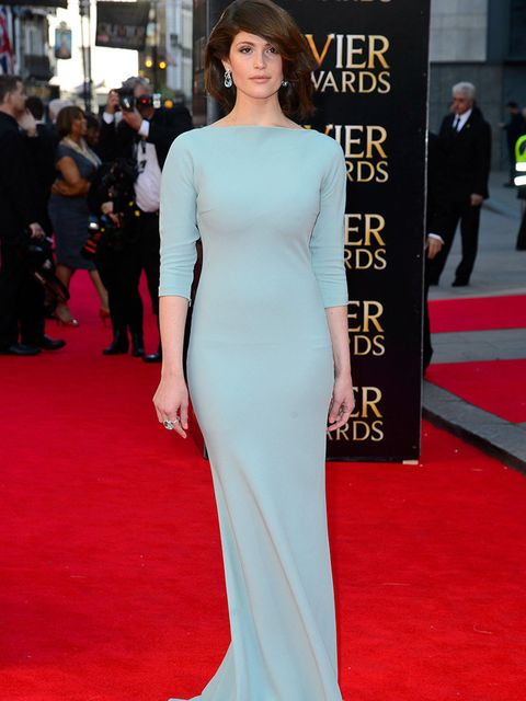 <p>Gemma Arterton wears a simple-yet-striking mint-green Prada gown to the Laurence Olivier Awards 2014 at The Royal Opera House in London.</p>