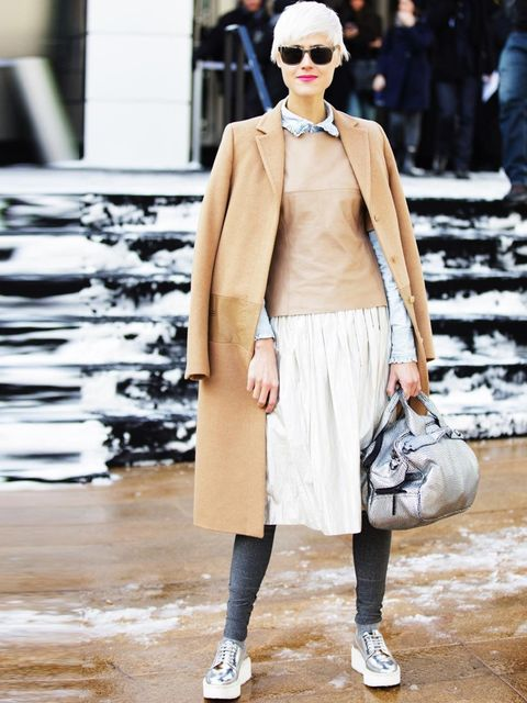 <p>A very feminine coat and skirt get a sporty edge with statement trainers, USA.</p>