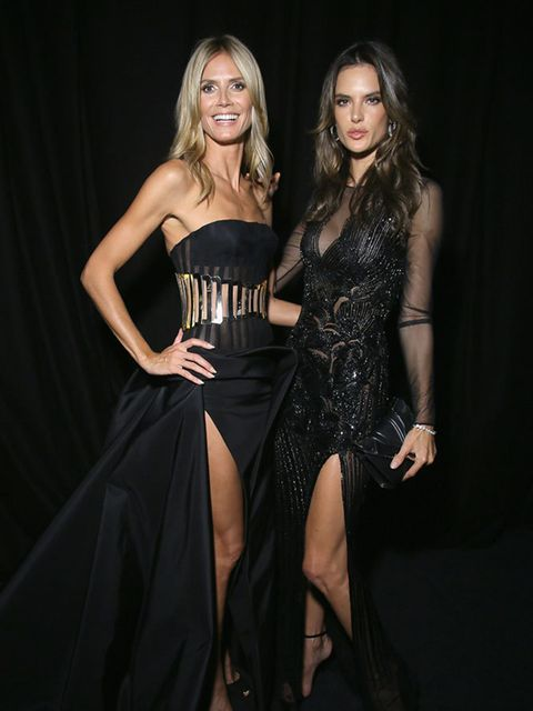 Heidi Klum and Alessandra Ambrosio attend the amfAR Milano 2014 - Cocktail as part of Milan Fashion Week Womenswear Spring/Summer 2015 on September 20, 2014 in Milan, Italy.