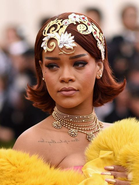 """<p>We love <a href=""""http://www.elleuk.com/fashion/celebrity-style/rihanna-s-style-file"""">Rihanna's</a> retro bob and intricate head piece, but it's her attention to the finer details that get us excited (notice the penciled beauty spot on her cheek).</p>"""