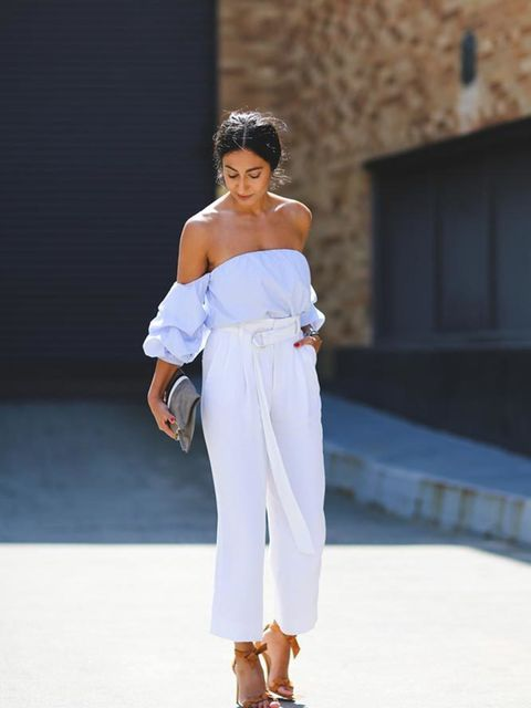 Nausheen Shah wearing a Johanna Ortiz top, Celiné trousers and carrying a Clare Viver clutch