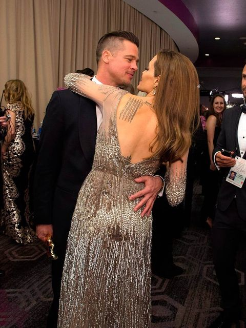 <p>Brad Pitt and Angelina Jolie celebrate backstage at the Academy Awards 2014</p>