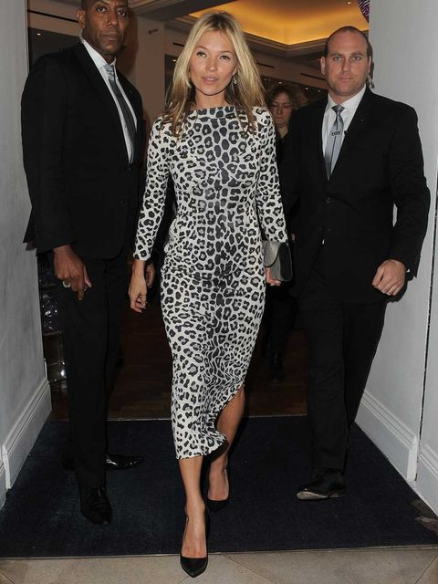 "<p>Kate Moss wore a leopard print <a href=""http://www.elleuk.com/catwalk/designer-a-z/marc-jacobs/spring-summer-2013"">Marc Jacobs Spring Summer 13</a> dress, and a Yves Saint Laurent silver metallic leather 'Chyc' clutch, to the signing event for her book"