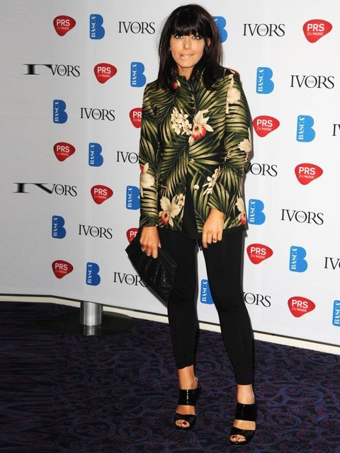 <p>Claudia Winkleman wears bold leaf print jacket and black tights to Ivor Novello Awards</p>