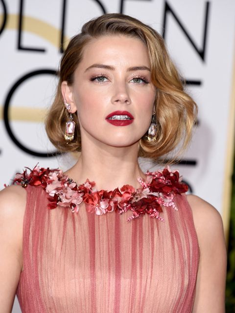 <p>Amber Heard's elegant faux bob and classic red lip worked perfectly with her delicate dress. </p>