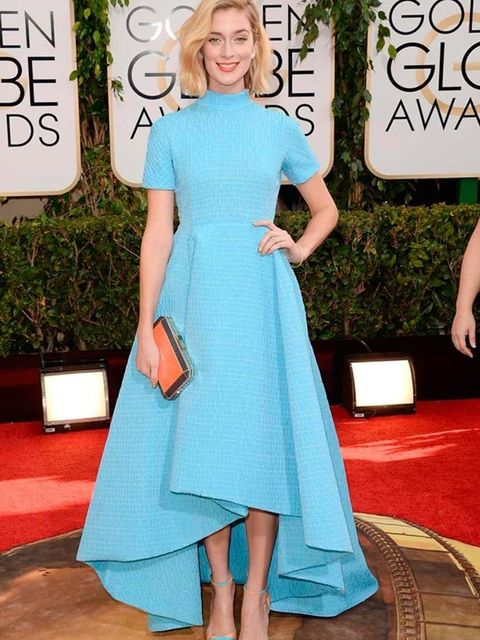 <p>Caitlin Fitzgerald wears a Emilia Wickstead dress and Anya Hindmarch <em>Duke Shagreen</em> clutch to the 71st Annual Golden Globe Awards, 2014. </p>