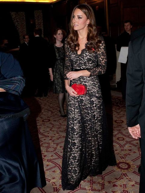 "<p>Kate Middleton wears a lace <a href=""http://www.elleuk.com/catwalk/designer-a-z/temperley-london/spring-summer-2013"">Temperley London</a> dress and a red <a href=""http://www.elleuk.com/catwalk/designer-a-z/alexander-mcqueen/spring-summer-2013"">Alexande"