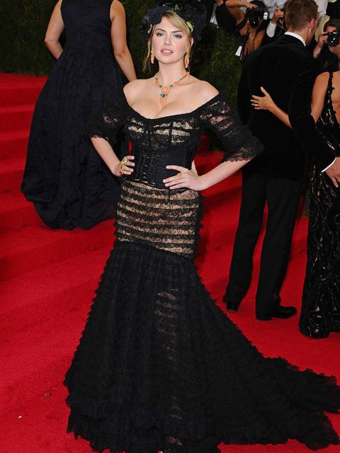 <p>Kate Upton wears a black tiered gown by Dolce & Gabbana to the Costume Institute Gala Benefit celebrating Charles James: Beyond Fashion, in New York.</p>
