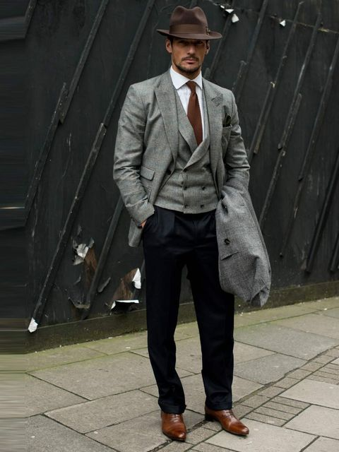 <p>David Gandy, Model. GB M and S coat, Neil Fennel October House Tailor suit, Thomas Pink shirt, Russell & Bromley shoes, Goorin Brothers hat, Reiss tie.</p>