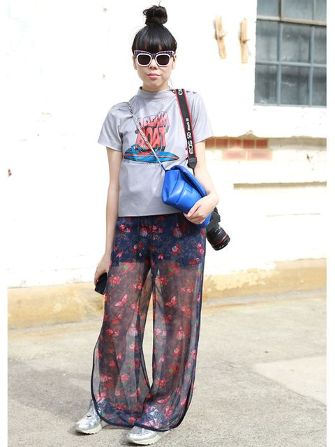 <p>Susie Lau wears Ashley Williams top, Sacai trousers, Nike trainers, Julian David bag.</p>