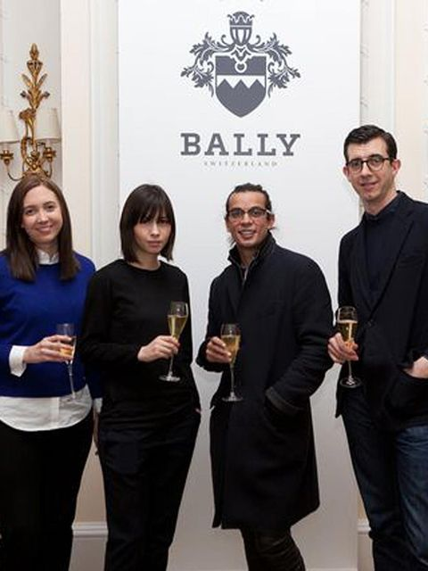 <p>CSM students Alice Bastin and Mei Lim Cooper taost to their collaboration with Bally's Creative Directors Micheal Herz and Graeme Fidler</p>