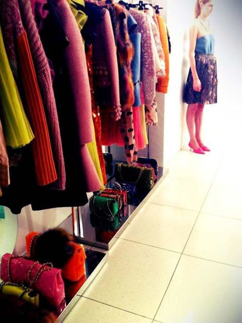 <p>A rail of clothes and a model in Moschino Cheap & Chic's A/W '12 collection</p>