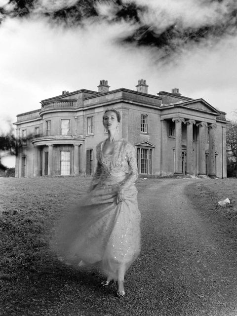<p>Della Oake wearing a Norman Hartnell gown in Clytha Park, 1951.</p>