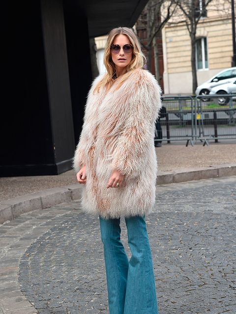<p>Poppy Delevingne arrives for the Miu Miu a/w15 show during Paris Fashion Week, March 2015.</p>