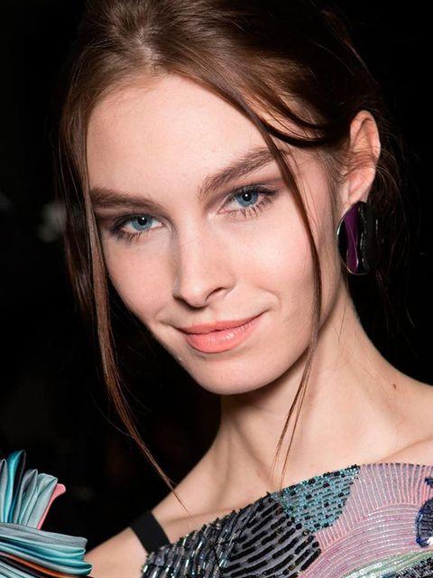 """<p><strong><a href=""""http://www.elleuk.com/catwalk/giorgio-armani/autumn-winter-2015"""">Giorgio Armani</a></strong></p>  <p>The look: Bella Ragazza</p>  <p>Make-up artist: Linda Cantello for GiorgioArmani Beauty</p>  <p>Key products: Armani Crema Nuda (out"""