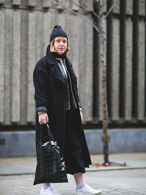 <p>Lena De Casparis, Culture Director</p>  <p>ASOS coat, Zara jacket, Monki top, Topshop trousers, Zara trainers, BaoBao Issey Miyake bag</p>