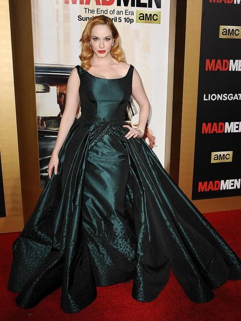At the Black and Red Mad Men Ball in March 2015, Christina Hendricks hit the red carpet in this statement dark green gown but there was more to this than first meets the eye...