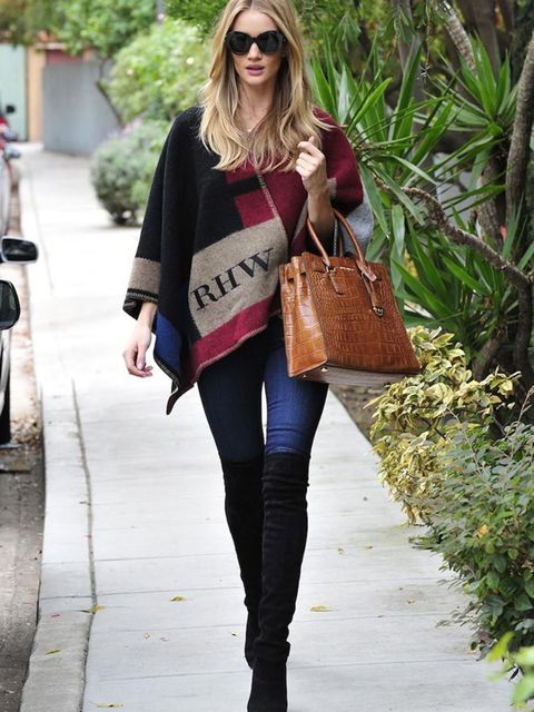 "<p><a href=""http://www.elleuk.com/fashion/celebrity-style/rosie-huntington-whiteley-style-file"">Rosie Huntington-Whiteley</a> wears a custom Burberry poncho while out and about in LA.</p>"
