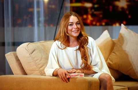 Lindsay Lohan with book | ELLE UK