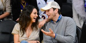 Mila Kunis and Ashton Kutcher at basketball game | ELLE UK