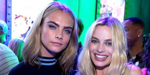 Cara Delevingne and Margot Robbie at Comic-Con 2016 | ELLE UK