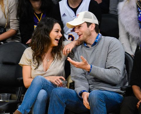 Mila Kunis and Ashton Kutcher at basketball game | ELLE UK