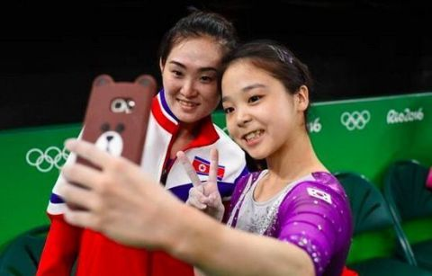 South Korean gymnast Lee Eun Ju and 2014 world champion Hong Un Jong of North Korea | ELLE UK