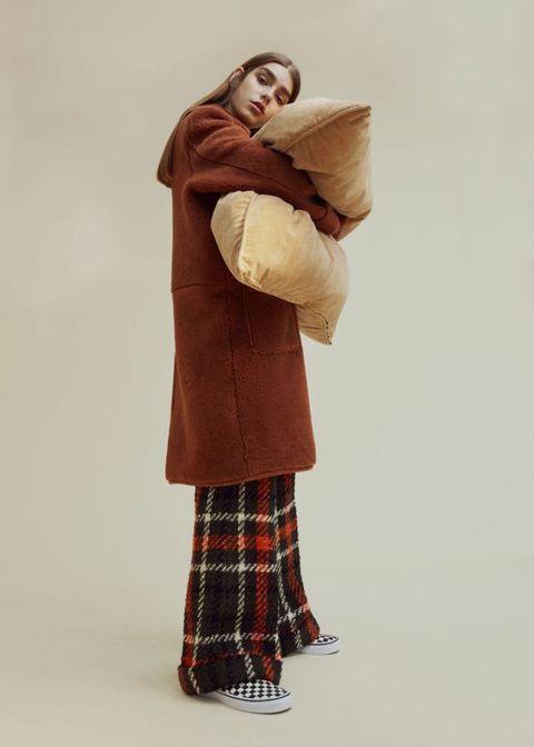 <p>Coat, £695 , Warehouse. Wool-mix trousers, £240, Bimba y Lola. Canvas trainers, £47, Vans.</p>