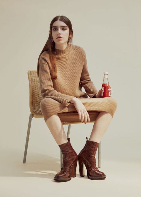 <p>Cashmere-mix jumper, £120, and matching skirt, £95, both Whistles. Patent-leather boots, £430, Carven. Silver-plated earrings, £159, Annelise Michelson</p>