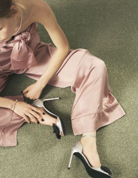 <p>Satin jumpsuit, £1,574, Zimmermann. Leather-mix sandals, £460, Saint Laurent. White-gold necklace, £2,485, white-gold bracelet, £950, and sterling  silver ring, £60, all Pandora</p>