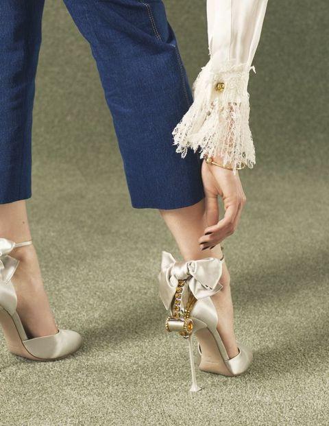 <p>Silk shirt, £1,220, Ermanno Scervino. Denim jeans, £209, Sandro. Silk and pearl shoes, £705, Miu Miu. Gold bangle, £700, Pandora</p>