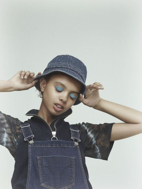 <p>Denim dungarees, £125, Miss Sixty. Denim top (worn underneath), £225, Marques'Almeida. Cotton t-shirt (worn underneath),£84, Aries. Denim hat, £40, Carhartt. Gold earrings (worn throughout), £150, Ernest Jones. Sterling silver and gold ring (worn throughout), £680, Bunney</p>