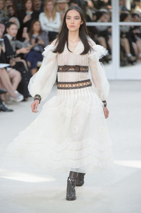 <p>Karl's turned the pretty dial up to eleven with this lacy number. Black boots and tights keeps the dress from being too bridal. </p>