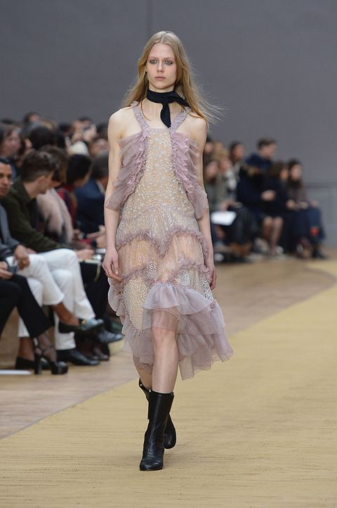 <p>Who would have thought it, pure girly frills in lilac and peach are literally the best combination. Like Karl, black accessories keep it from getting too Sandra Dee. </p>