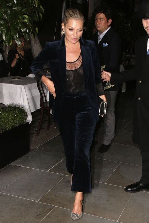Kate Moss wearing a velvet suit