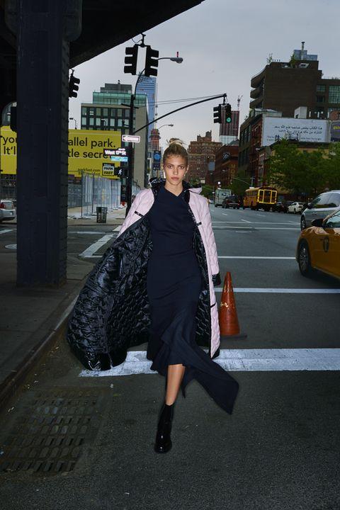 Outerwear, Road surface, Asphalt, Coat, Street fashion, Urban area, Street, Automotive parking light, Bag, Alloy wheel,