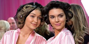 Gigi Hadid and Kendall Jenner backstage in robes and curlers at Victoria Secret