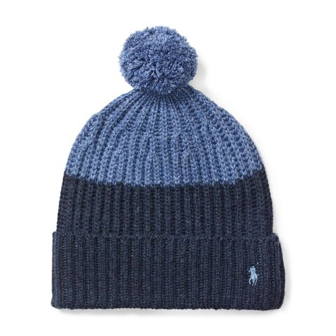 """<p><strong data-redactor-tag=""""strong"""" data-verified=""""redactor"""">Color-Blocked Pom-Pom Knit Hat, £69</strong></p><p>Whether he's mastering the moguls or soaking in the hot tub, this chunky knit hat will keep him warm and toasty.<span class=""""redactor-invisible-space"""" data-verified=""""redactor"""" data-redactor-tag=""""span"""" data-redactor-class=""""redactor-invisible-space""""></span></p>"""