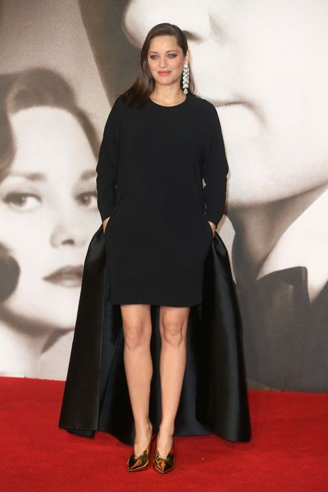 "<p>In custom-made Stella McCartney at the UK premiere of <em data-redactor-tag=""em"" data-verified=""redactor"">Allied.</em></p>"