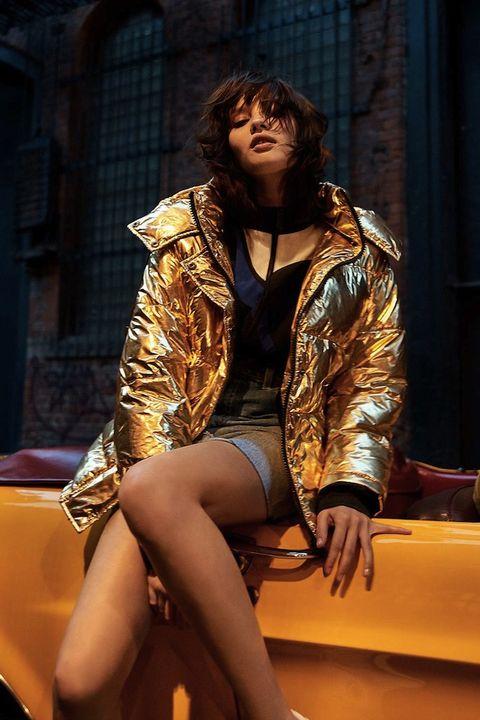 Leg, Human leg, Sitting, Thigh, Jewellery, Jacket, Knee, Fashion model, Fashion design, Curtain,