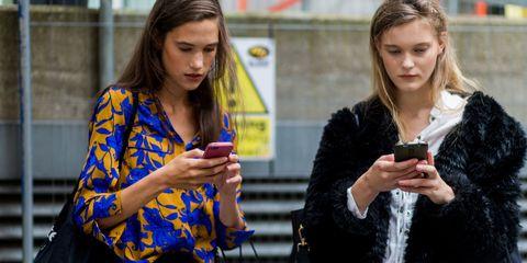 Uber models on phone   ELLE UK