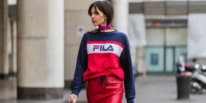 Doina Ciobanu wearing a Fila sweater at Milan Fashion Week