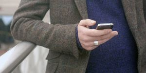 man on mobile phone texting - using new fertility app to test male fertility