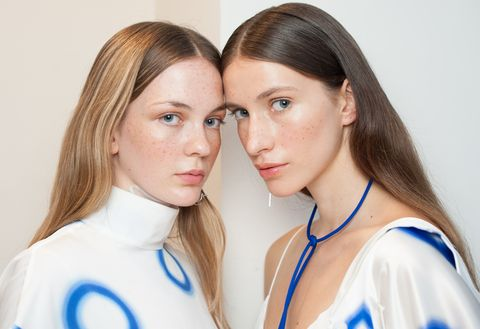 Two models with glowing skin at London Fashion week